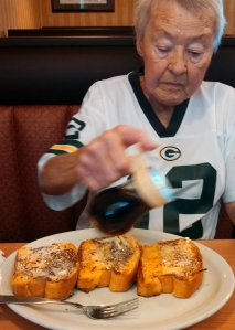 "John said of his mother, ""She loved Aaron Rodgers of The Green Bay Packers and french toast. This is the picture used at her memorial and I can say it was real to all who attended."""