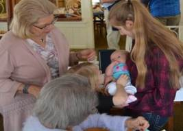 Sally, her mother Marilyn, her granddaughter Addi,  and her daughter Rebecca holding her grandniece