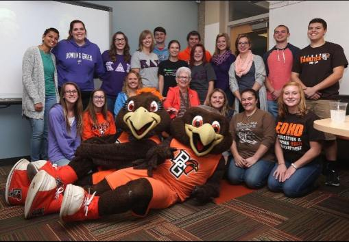 This picture includes Kappa Delta Pi members old and new, as well as Freddie and Frieda Falcon, with Muriel Hutchinson Strebe in the center.